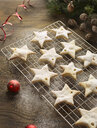 Christmas star biscuits on cooling rack - CUF15526