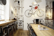 Quirky coffee shop interior with bicycle on wall - CUF15610