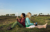 Children using miniature wind turbine to power digital tablet, Breda, Netherlands - CUF16282