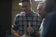 Men with pool cue smiling - CUF16711