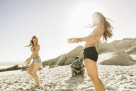 Adult female friends dancing together on beach, Cape Town, South Africa - CUF16969