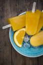 Home-made orange popsicles in bowl - LVF07009