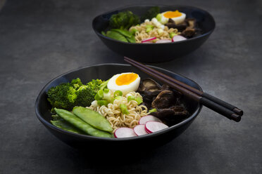 Ramen soup with egg, sugar peas, broccoli, noodles, shitake mushroom and red radish - LVF07012