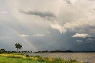 Germany, Ruegen, Middelhagen, Moenchgut, rainbow above the water - MJF02274