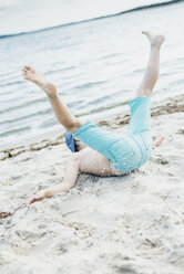 Playful boy having fun on the beach - MJF02286