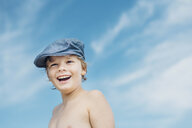 Portrait of happy boy wearing a cap outdoors - MJF02289