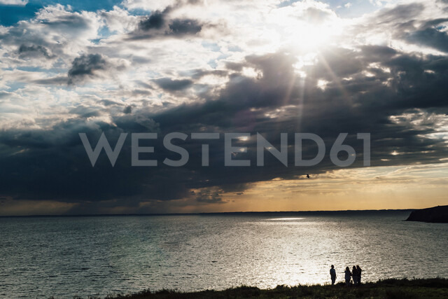 Germany, Ruegen, people at the coast and Baltic sea under cloudy sky - MJF02298