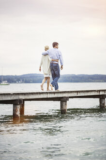 Mature couple walking on pier, rear view - CUF17401