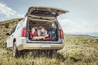 Mature man and teenage son pointing whilst reading map from off road vehicle, Bridger, Montana, USA - CUF17416