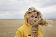 Woman with windswept hair, Sudurland, Iceland - CUF17440