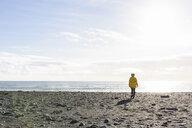 Woman enjoying beach, Reynisfjara, Iceland - CUF17512