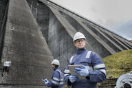 Portrait of worker at foot of dam at hydroelectric power station - CUF18006
