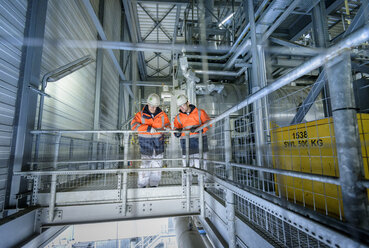 Workers on high level walkway in gas-fired power station - CUF18139