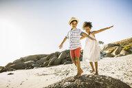 Children balancing on rock - CUF18309
