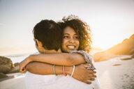Couple hugging on beach - CUF18360