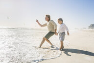 Father and son on beach - CUF18384
