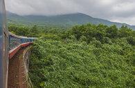 Train crossing bridge, moving through Binh Dinh Province, Vietnam - CUF18843