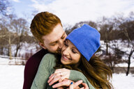 Romantic young couple  in snowy Central Park, New York, USA - ISF07227