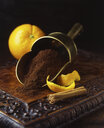 Fresh oranges and peels with cinnamon stick and freshly ground coffee in vintage scoop - ISF07293