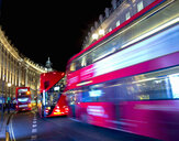 Blurred motion of buses on Regent Street, London, UK - CUF19074