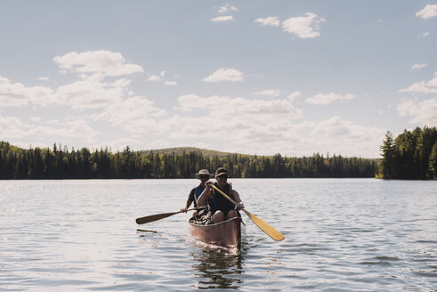 Senior couple canoeing on lake - CUF19185