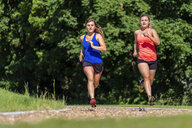 Female joggers on woodchip trail - STSF01588