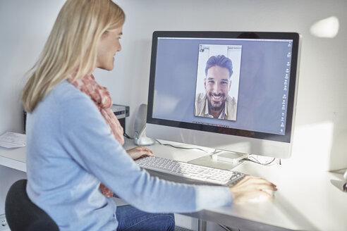 Woman making desktop video call to boyfriend - CUF19624