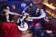 Friends toasting at Halloween party - ABIF00484