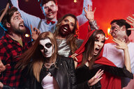 Friends in creepy costumes having fun at Halloween party - ABIF00505