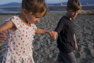 Children playing on beach, Vancouver, British Columbia, Canada - ISF07445