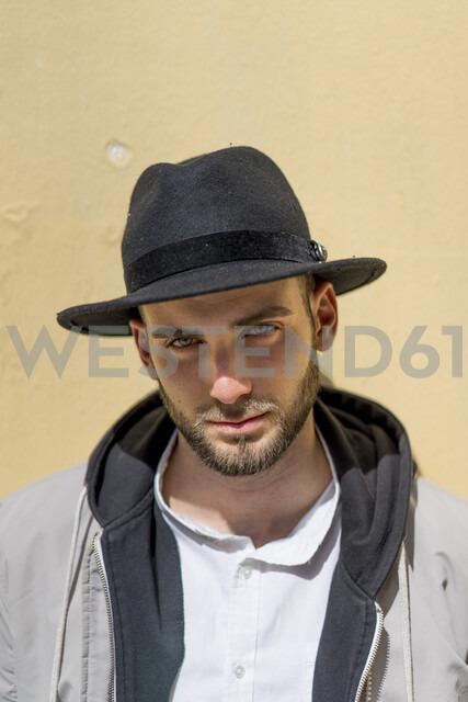 Portrait of bearded man wearing black hat - AFVF00587