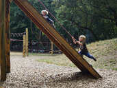 Two little boys having fun on playground - MUF01544