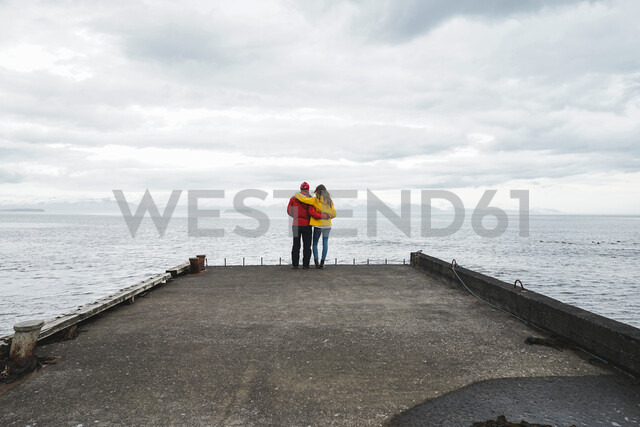 Iceland, North of Iceland, back view of couple standing on jetty looking at view - AFVF00599 - VITTA GALLERY/Westend61
