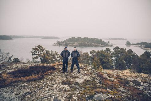 Sweden, Sodermanland, two men standing at archipelago landscape - GUSF00941