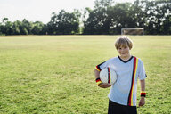 Boy wearing German soccer shirt, holding football - MJF02308