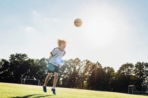 Boy wearing German football shirt playing soccer - MJF02329