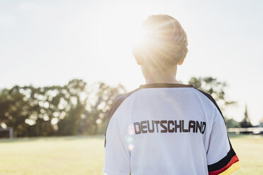 Boy wearing football shirt with Germany written on back - MJF02332