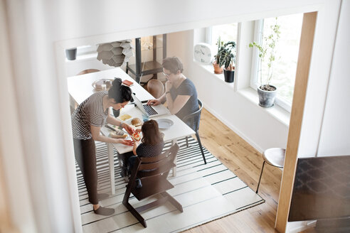 High angle view of family having breakfast at dining table - MASF07772