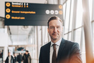 Portrait of confident mature businessman in airport terminal - MASF07811