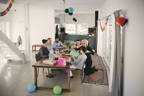 High angle view of family enjoying birthday party at home - MASF07934