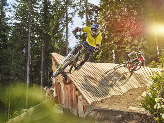 Austria, Tyrol, male and female downhill mountain biker - CVF00643