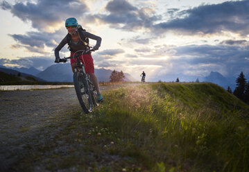 Austria, Tyrol, male and female downhill mountain biker - CVF00649