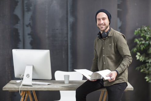 Portrait of smiling young man in office - ZEF15520