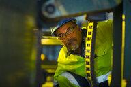 Engineer in industrial plant inspecting machines - ZEF15588