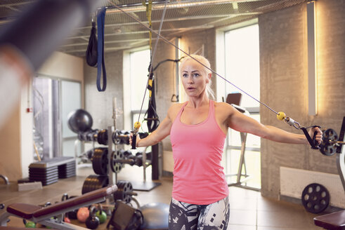 Woman working out in gym - CUF21390