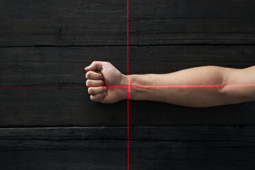 Human hand getting scanned by red light rays - PDF01665