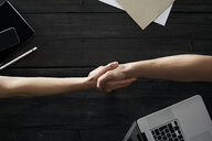 Partners shaking hands in office - PDF01695