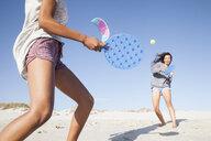 Women on beach playing tennis - CUF21466