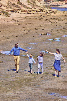 Australia, Adelaide, Onkaparinga River, happy family walking together hands in hands at beach - BEF00137