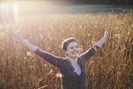 Portrait of happy woman relaxing in nature - PNEF00640